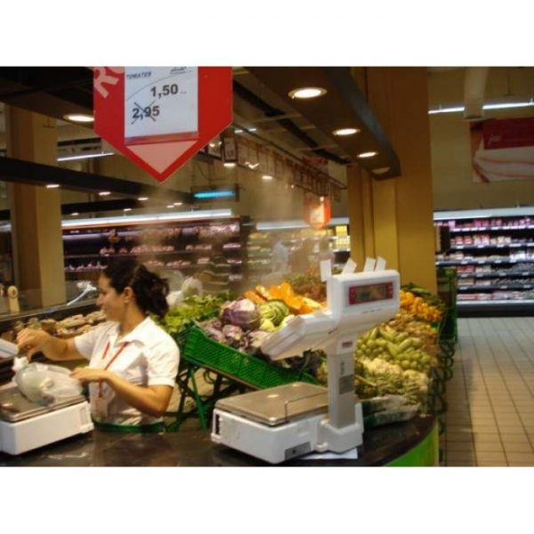 Fresh produce misting in supermarket
